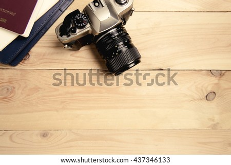 Camera with passport and notebook on table - Travel concept - stock photo