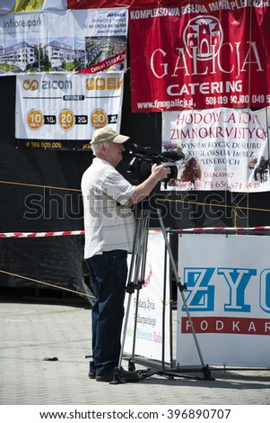 """Cameraman at work. 14 Great Charity Picnic """"Holidays without barriers"""" Poland City Przemysl Street Sanocka 14.06.2015 - stock photo"""
