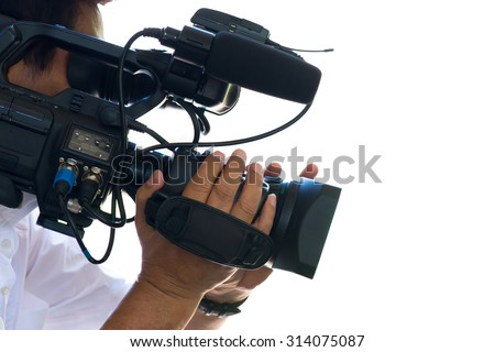 Cameraman working on white background - stock photo