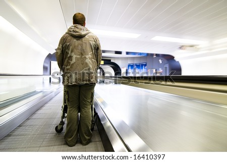 Camouflage clothing man at the airport. - stock photo