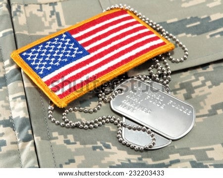 Camouflage uniform, dog tags, American Flag - stock photo