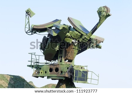 Camouflaged mobile military radar, can be used with missile launcher - stock photo