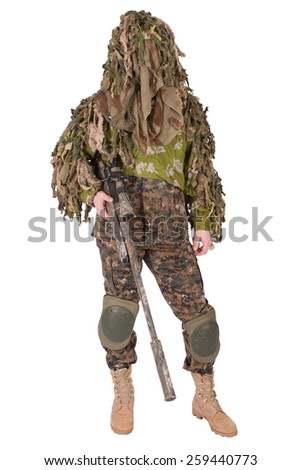 Camouflaged sniper in ghillie suit isolated - stock photo