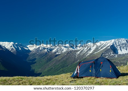 Camp at the mountain pass with amazing view, Altai - stock photo