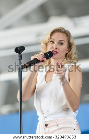 CAMP SPRINGS, MD, USA - SEPTEMBER 19, 2015: Laura Bell Bundy performs during the 2015 Joint Base Andrews Air Show held at Joint Base Andrews in Camp Springs Maryland. - stock photo