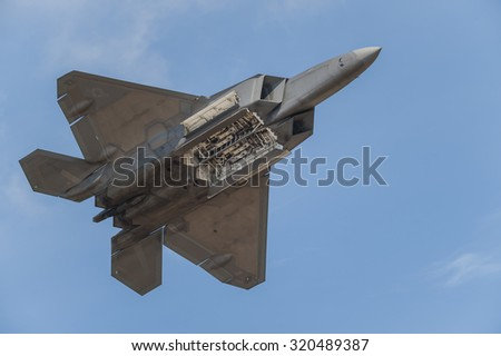 CAMP SPRINGS, MD, USA - SEPTEMBER 19, 2015: The F-22 performs during the 2015 Joint Base Andrews Air Show held at Joint Base Andrews in Camp Springs Maryland. - stock photo