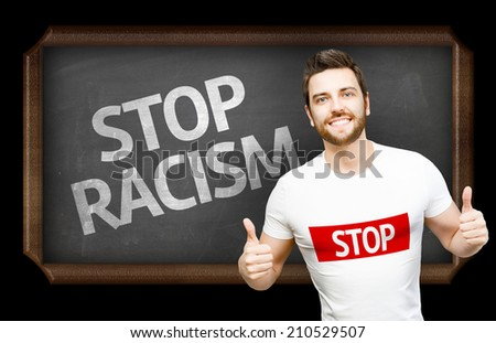 Campaign against Racism by a man on blackboard background - stock photo