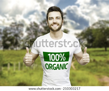 Campaign 100% Organic by a man on a beautiful day - stock photo