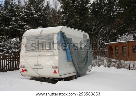 camper covered snow in winter - stock photo