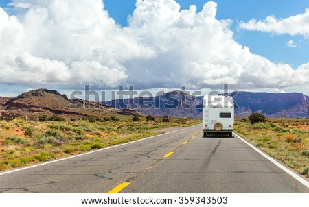 Camper trailer on Highway in USA, road trip in motorhome - stock photo