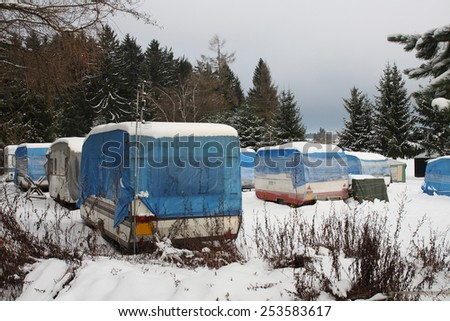 campers covered by  snow in winter - stock photo