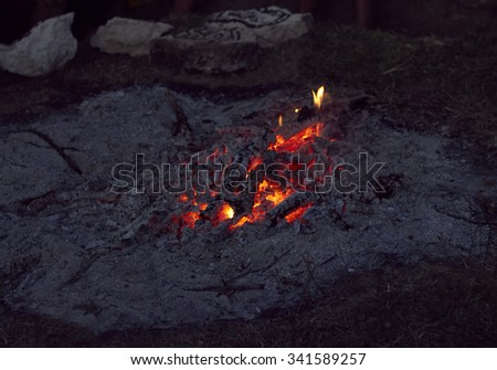 Campfire from firewood and ashes outdoors - stock photo