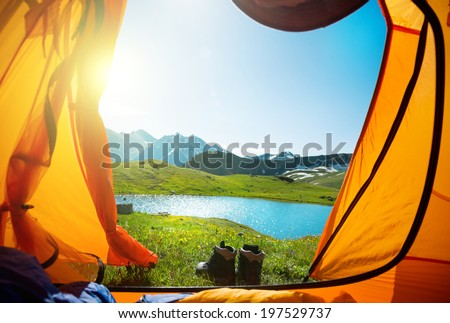 camping and hiking in mountains - stock photo