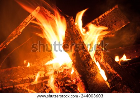 Camping Bonfire with sparks at night time - stock photo