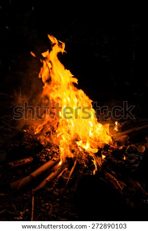 Camping Bonfire with sparks at night time. - stock photo