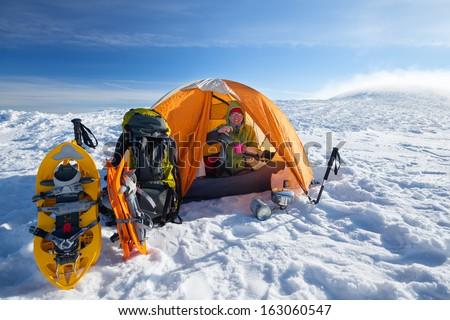 Camping during winter hiking in Carpathian mountains - stock photo