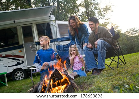 Camping: Family Having Marshmallow Fun By Campfire - stock photo