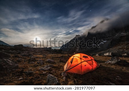 Camping in the mountains. Moon night - stock photo