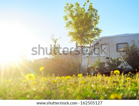 Camping site in the morning sun - stock photo
