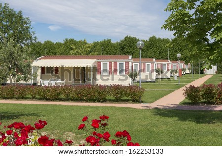 camping site with rows of identical mobil homes - stock photo