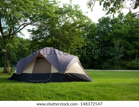 Camping Tent at Campground during Daytime in Woods - stock photo