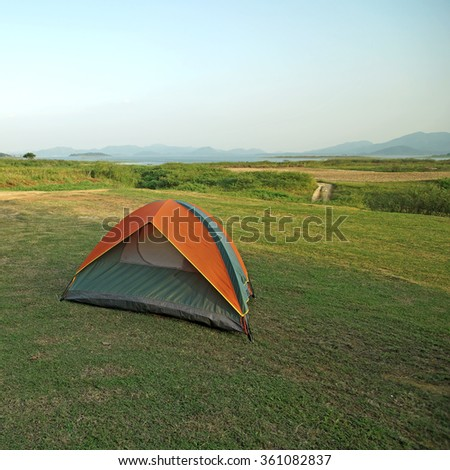 camping tents at a camp site with mountain background - stock photo