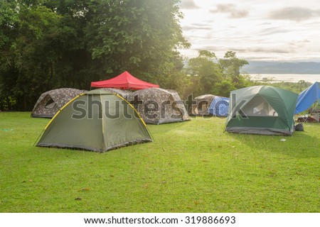 Camping tents on the lawn, a relaxing time with nature. - stock photo