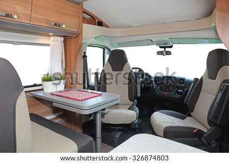 Camping van interior cabin with seating for four - stock photo