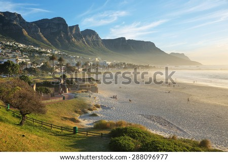 Camps Bay Beach in Cape Town, South Africa, with the Twelve Apostles in the background. - stock photo