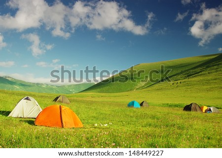 Campsite in the mountains - stock photo