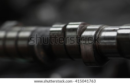 camshaft removed for repair or inspected, the shaft controlled function of intake and exhaust valve, Machine equipment of vehicles, repair machine job in the garage. - stock photo