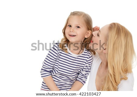Can not believe. Studio shot of a cheerful mother whispering secrets to her surprised little daughter isolated on white. - stock photo