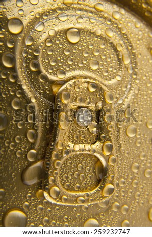 can of beer in drops of water as a background - stock photo