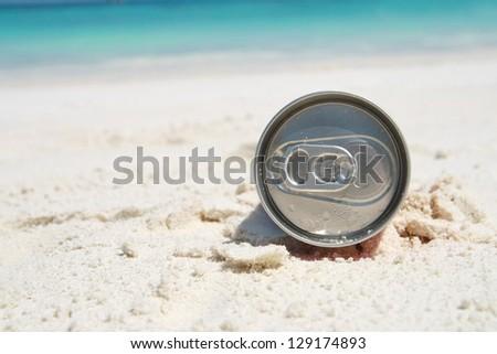 can on beach - stock photo