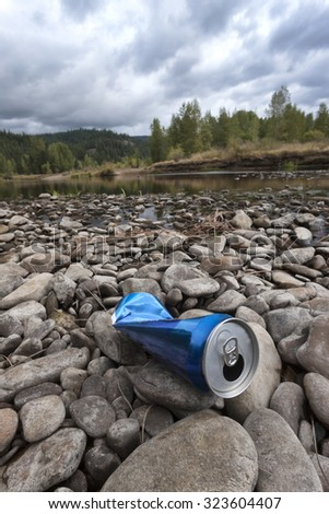 Can on the rocks in the river in north Idaho. - stock photo