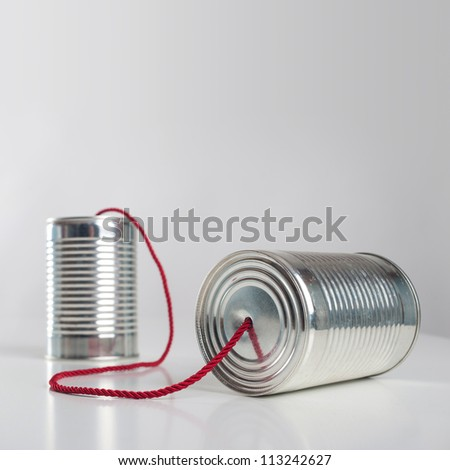Can telephone with red wire. Conceptual communication image. - stock photo