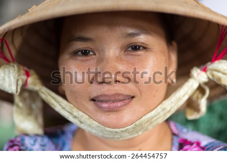 CAN THO, VIETNAM, DECEMBER 11, 2014:Portrait of a woman selling soya milk in the covered Tan An market in Can Tho city, Vietnam. - stock photo