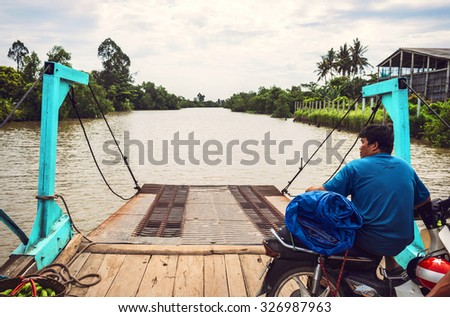 Can Tho, Vietnam - 5 March 2015: People doing thier normal life by the river. The boat is the most common transportation mean of rural people in Mekong delta Vietnam. - stock photo