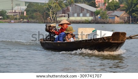 Can Tho, Vietnam - 5 March 2015: Woman moving by rowing boat, the most common transportation mean of rural people in Mekong delta Vietnam - stock photo