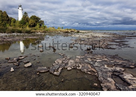 Cana Island Lighthouse reflected. Baileys Harbor, Wisconsin, USA. - stock photo