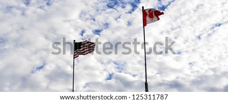 Canada and USA flag in the air - stock photo