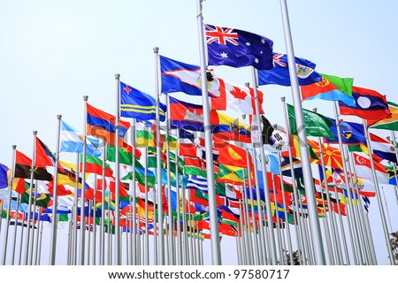 Canada Brazil British Commonwealth and world national flags is flying - stock photo