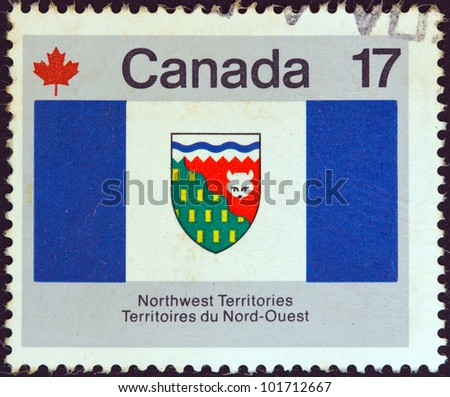 """CANADA - CIRCA 1979: A stamp printed in Canada from the """"Canada Day. Flags"""" issue shows Northwest Territories flag, circa 1979. - stock photo"""