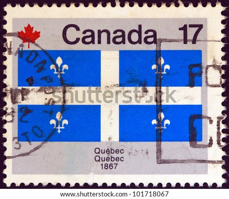 """CANADA - CIRCA 1979: A stamp printed in Canada from the """"Canada Day. Flags"""" issue shows Quebec flag, circa 1979. - stock photo"""