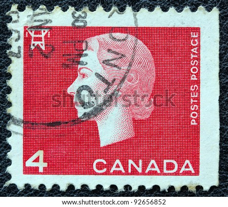 CANADA - CIRCA 1962: A stamp printed in Canada shows a portrait of Queen Elizabeth II and Electricity pylon symbol, circa 1962. - stock photo