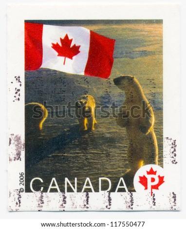 CANADA - CIRCA 2006: A stamp printed in Canada, shows Canadian Flag and polar bear, circa 2006 - stock photo