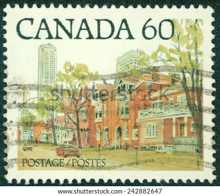 CANADA - CIRCA 1982: Postage stamp printed in Canada with image of a Canadian urban landscape. CIRCA 1982 - stock photo