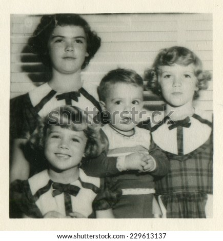 CANADA - CIRCA 1960s: Vintage photo shows group portrait of children. - stock photo