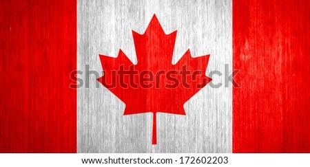 Canada Flag on wood background - stock photo