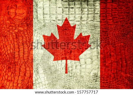 Canada Flag painted on luxury crocodile texture - stock photo